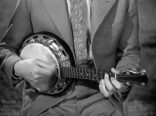 George Formby playing the Banjolele